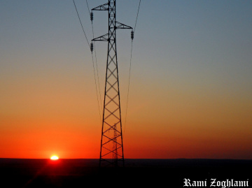 Sunrise and electric pole